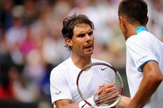 Rafael Nadal and Lukas Rosol shake hands on Centre Court