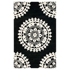 Add a pop of pattern to your living room or den with this hand-tufted wool rug, showcasing a medallion motif in black and ivory.  Pr...