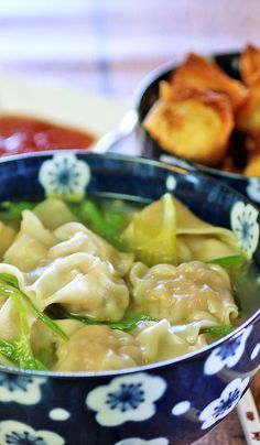 Wonton Soup - Delicious pork filled dumplings in chicken broth with pea pods and green onions.