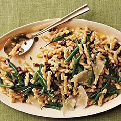 Haricots verts are thin, tender green beans. If you can't find them, use trimmed regular green beans, but add them to the pasta after 8 minutes of cooking since they'll take longer to cook. You can make the salad ahead, but dress it just before serving so the beans don't turn drab.