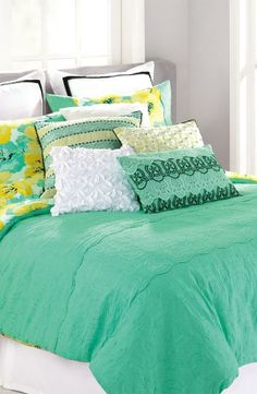Fresh and bright for spring! Love the mixed patterns and textures on this bedding collection.