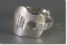 Classic Guitar ring!    http://www.guitarjewelry.com/gfx/large/SR1252_SM.jpg