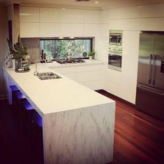 A beautifully renovated kitchen in Warwick. Corian® raincloud used to Complete…