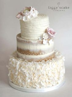 Neapolitan | Wedding Cake. Top tier textured buttercream followed by a polished naked cake and coconut shards covered buttercream base. Decorated with beautiful sugar flowers.