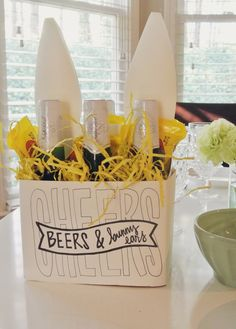 Cheers, Beers, & Bunny Ears. Cute way to bring booze over to someone's house for Easter.