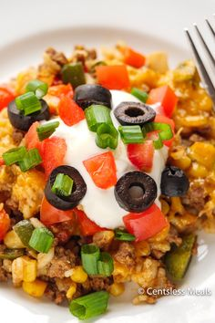 Easy Taco Casserole is made with spicy beef, rice, tomatoes, mexicorn, salsa and topped with loads of cheese. Try mixing things up by substituting the beef with chicken! #centslessmeals #easytacocasserole #tacobakecasserole #tacoricecasserole #simplerecipe #withrice #bakesimple #groundbeef #easyrecipe #casserole Taco Casserole With Rice, Taco Rice, Casserole Dishes, Casserole Recipes, Cowboy Casserole, Chicken Casserole, Mexican Food Recipes, Beef Recipes, Recipies