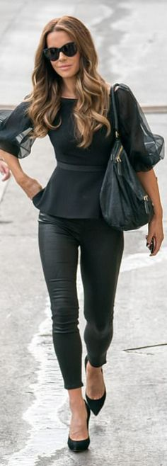 Who made Kate Beckinsale's sunglasses, peplum mesh top, suede black pumps, leather pants, and handbag?