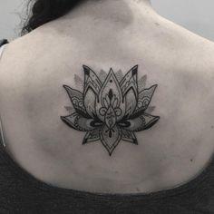 Lotus back tattoo by @jamieeddytattoo