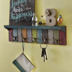 Incorporate some color into your home with our eye-catching Colorful Multi Wall Hook! The distressed wood finishing softens the brightness, making this wall hook the perfect subtle pop of color for your entryway. With 5 hooks to choose from, your family will never loose their keys again!