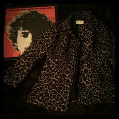 Vintage Leopard Raincoat Awesome leopard coat, great alternative to boring khaki raincoats. The coat is 100% polyester. Very light weight. Originally bought at Target. I loved wearing this coat on those rainy/muggy days. It no longer fits. It's a medium petite, but I think this would best fit a small. Not great for larger chest sizes. Jackets & Coats