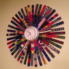 "4th graders painted shims, glued and secured into very large starburst, clock mounted on front. Could use mirror as another option. ""Time for 4th grade"" Silent auction art"