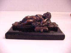 antique paperweight bronze cherub sleeping on corn, jesus figure