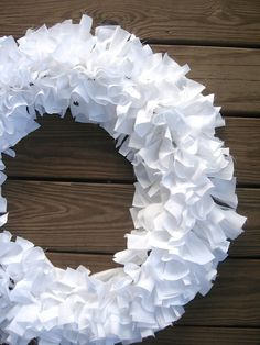Learn how to make this simple shabby chic rag wreath using strips of fabric. Easy and so adorable!