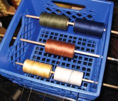For winding a warp in several colors at once.. beats having the spools jump and roll across the floor and get all tangled, my usually way