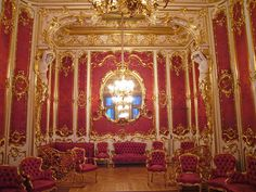 """Hermitage, thePlace of Solitude.  Super ornate rococo style in deep redcolorfrom the Old Russia.  The name of the Hermitage Museum, in St. Petersburg, Russia, came from the French and it means the """"place of solitude.""""  This was true when it was the Tsar's private museum."""