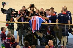 Britain's Chris Hoy celebrates after their track cycling men's team sprint finals at the Velodrome during the London 2012 Olympic Games. STEFANO RELLANDINI/REUTERS