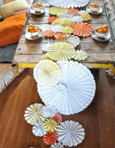 Add a colorful burst of whimsy to your table with this pretty pinwheel table runner. Green Wedding Shoes has a DIY tutorial here!
