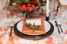 """Corals, oranges, and hints of charcoal dance across this linen. It is inspired by the beaches of Perdido Key, Florida, one of the most northwesterly points in the state. """"Perdido"""" translates to """"lost,"""" but your guests will feel themselves found by a tablescape that evokes the little-known but breathtaking beaches of Perdido."""