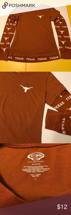 """Texas Longhorns T Shirt juniors L 2-layer look Texas t-shirt. Longhorns burnt orange color. Juniors size large. One piece with a 2-layer look. 100% cotton. 24"""" long. 23"""" long sleeves. Approx. 17 1/2"""" across front bust area but will stretch to a little bit more. In good condition. Tops Tees - Long Sleeve"""