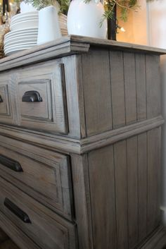 Driftwood Gray paint/stain color.  Easy and complete tutorial on her blog.  The dresser is a beauty~
