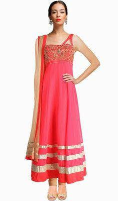 Evoke patience worthy admiration dressed in this fuchsia net embroidered gown. The ethnic floral patch, lace, resham and stones work over a dress adds a sign of beauty statement for the look. #AwesomeDesignerCollection
