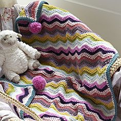 How to make a cosy crocheted buggy blanket: This comfy crocheted blanket can be made in a rainbow of different colours and is just the right size to keep the little one tucked snugly in a stroller or car seat. Crochet Afghans, Crochet Ripple Blanket, Ripple Afghan, Chevron Blanket, Crochet Blankets, Baby Blankets, Crochet Crafts, Crochet Yarn, Crochet Projects