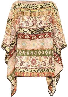 We adore Etro's bold approach to everyday glamour, a mood displayed by this poncho from the label's Pre-Fall collection. The style has been made in Italy from a silk-blend fabric in earth tones. Layer yours with wide-leg denim . Bohemian Look, Modern Bohemian, Wool Poncho, Lace Silk, Wide Leg Denim, Mixing Prints, Chiffon Tops, Wool Blend, Paisley