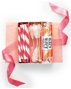 Taffy, rock candy, and candy sticks for a cute candy favor box #partyfavors