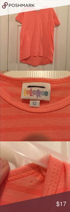 NWOT Lularoe gracie tunic Cute orange striped Lularoe gracie tunic, nwot, has a small hole by the neckline that is shown in the picture, otherwise great condition and never worn. LuLaRoe Shirts & Tops Tees - Short Sleeve