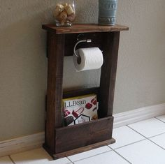 Handcrafted toilet paper holder stand with shelf and storage pocket. The perfect addition to any home bathroom or apartment. It has been lightly sanded by hallie