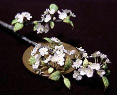 Miniature cherry blossoms by Shimako Hoshino dba Makorin Miniatures. She does incredible work.