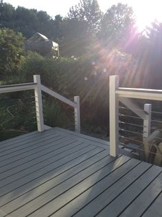 Grey and white decking with white vinyl railing looks great on any