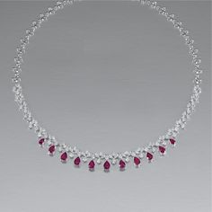 RUBY AND DIAMOND NECKLACE Of fringe design, set to the front with a graduated series of pear-shaped ruby drops, to a marquise and brilliant-cut diamond line, length approximately Diamond Earrings Indian, Ruby And Diamond Necklace, Gold Necklace Simple, Simple Jewelry, Jewelry Ideas, Pearl Necklace Designs, Garnet Jewelry, Gold Jewellery Design, Ring Verlobung