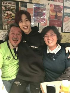 Mark with... his parents?