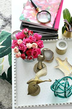 Bliss at Home 2015 Summer Home Tour with green and berry pink: coffee table styling with vintage brass herons, pink roses, Jonathan Adler zebra dish, glass knot, DIY agate coasters, and coffee table books