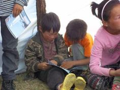 Learning: http://2secondstreet.wordpress.com/2013/08/22/summer-school/  Reindeer children studying English in our teaching tent.  Picture taken in the Eastern Taiga, Khuvsgul aimag, Mongolia.
