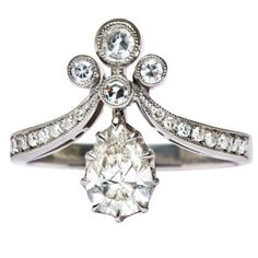 Platinum Tiara Engagement Ring set with a .71 carat Diamond | From a unique collection of vintage engagement rings at http://www.1stdibs.com/jewelry/rings/engagement-rings/