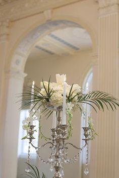 Candelabra Centerpiece With Flowers and Palm Fronds Candelabra Centerpiece, Centerpieces, Bee Invitations, Wedding Blog, Wedding Stuff, Wedding Ideas, Church Wedding Decorations, Palm Fronds, Elegant Wedding