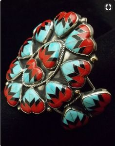 Cuff | O Moses. (Navajo). Nickel silver, coral, turquoise and jet.