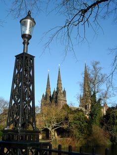 Three Spires of Lichfield Cathedral, looking across Minster Pool, Staffordshire, England.