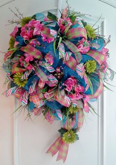 Beautiful turquoise deco mesh wreath with hot pink hydrangeas, lime green Gerbera daisies and fun ribbons