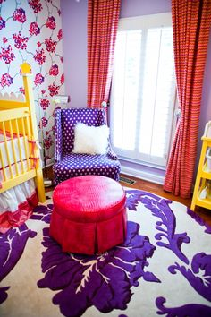 love the bold colors, the wallpaper accent wall, the purple flower RUG!