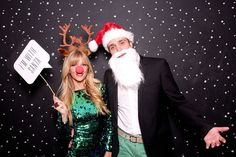Christmas Photo Booth! Get some antlers, Santa Hats and antlers and a but of cheesy decor and you've got a great set up. Use dark grey paper and paint on some snowflakes for a simple backdrop!