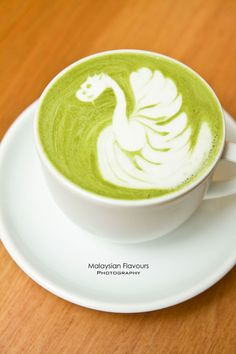 Green tea latte, playfully finished with a swan with ..dragon head? #coffee #coffeeart #cafe #malaysiacoffee