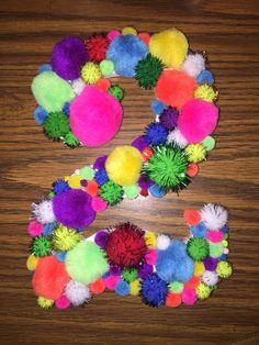 2! Using a wooden number, hot glue gun & Pom poms. Easy, cute & fun!