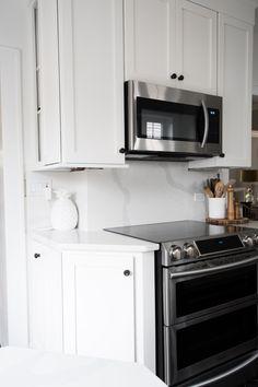 white quartz countertop and quartz backsplash slab Granite Tile Countertops, Quartz Backsplash, Quartz Slab, Kitchen Backsplash, Backsplash Ideas, Small Galley Kitchens, White Kitchens, Dark Kitchen Cabinets, Lowes Home Improvements