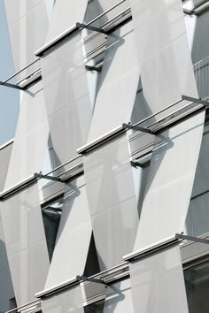 ideas that changed architecture #62 - cladding  A new way to look at blinds or curtains. Here, sun protection is provided by twisted textile materials.  F40 Office Building / Petersen Architekten
