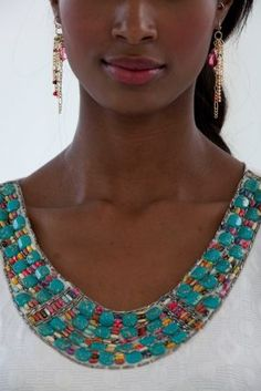T shirt Restyle - beading continues to be seen everywhere so why not take a t shirt that you like but give it new life...beads are inexpensive and can be thrifted or you can break up a necklace you are tired of and use the beads