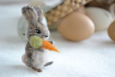 tiny felted rabbit. needle felted wool bunny by FibersofBeing, $17.00.  (I might have to branch out away from jewelry and rocks.?.)