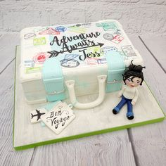 Suitcase cake with traveller